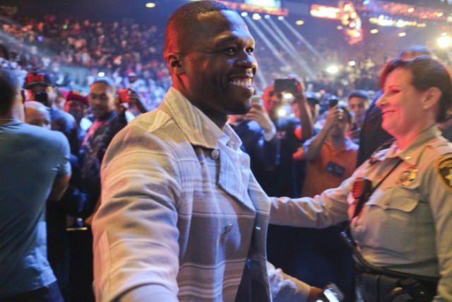 50 Cent and Gayle King share a warm embrace after Mayweather Pacquiao Weigh-In